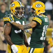 Green Bay Packers receiver Myles White (19) congratulates running back Rajion Neal (34) after his touchdown run against the Philadelphia Eagles at Lambeau Field August 29, 2015.