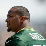 Green Bay Packers defensive tackle Mike Daniels looks on during training camp practice at Ray Nitschke Field on Saturday, Aug. 15, 2015.