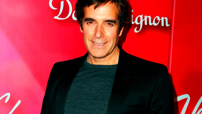 """In this Feb. 18, 2012 file photo, Illusionist David Copperfield arrives at the Keep Memory Alive 16th Annual """"Power of Love Gala"""" honoring Muhammad Ali with his 70th birthday celebration, in Las Vegas."""