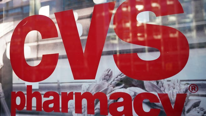 The CVS logo is seen infront of one of its stores in Washington, D.C. on The pharmacy chain CVS has agreed to buy medical insurer Aetna for around $69 billion, according to reports.