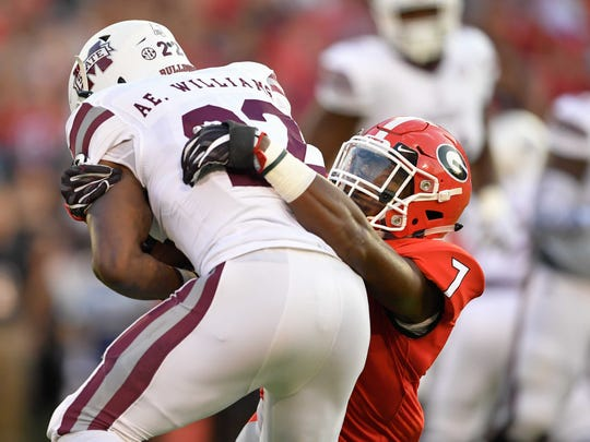Sep 23, 2017; Athens, GA, USA; Mississippi State Bulldogs running back Aeris Williams (22) is tackled by Georgia Bulldogs linebacker Lorenzo Carter (7) during the first quarter at Sanford Stadium. Mandatory Credit: Dale Zanine-USA TODAY Sports