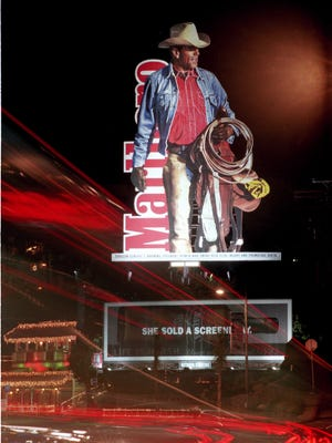 In the late 1990's Marlboro men were still used to advertise cigarettes.  This picture shows a  billboard on Sunset Blvd. in Los Angeles, Calif. in 1998.