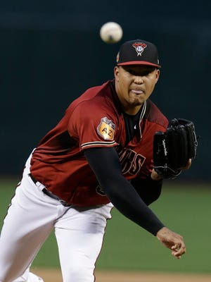 Mar 30, 2017: Arizona Diamondbacks starting pitcher Taijuan Walker (99) throws in the first inning during an spring training exhibition game against the Cleveland Indians at Chase Field.