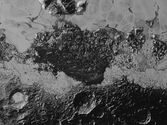New Pluto photos leave NASA scientists 'reeling'