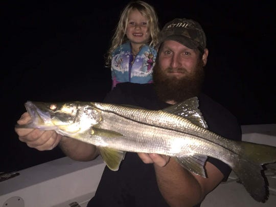 McKenna, 4, and J.J. Klarmann of Stuart caught a few slot snook this fall. Harvest of snook are prohibited from Dec. 15 through Jan. 31, 2017.