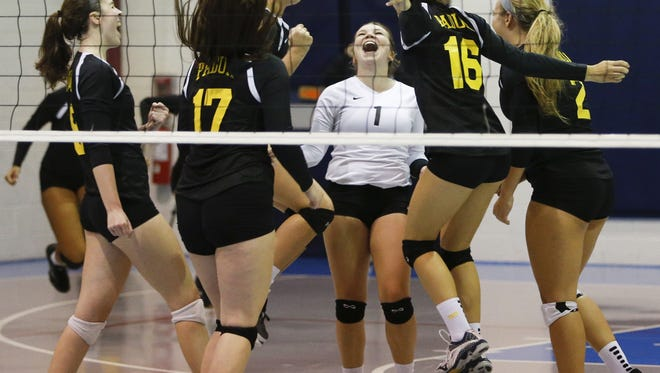 The Padua volleyball team celebrates its 3-0 sweep at Delaware Military Academy last Thursday, a win that pushed the Pandas to No. 1 in The News Journal rankings.