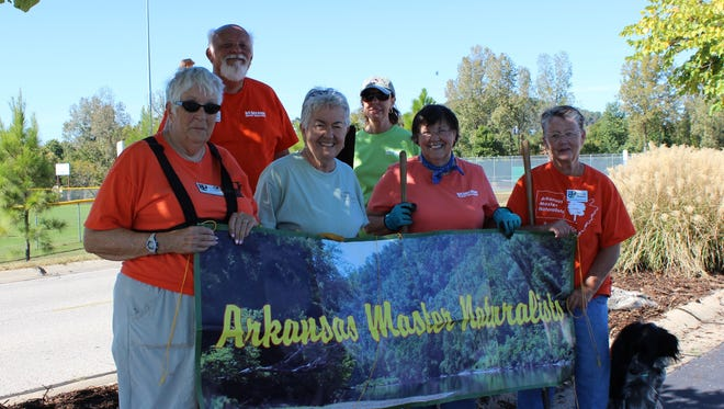 Anita Hayden, Pete Gunnell, Rebecca Glasscock, Connie Jacobs, Ginger Turk Tommie Walton, and dog Charlie are among 32 local Master Naturalists who spruced up benches, picnic tables and landscaping recently in Cooper Park.