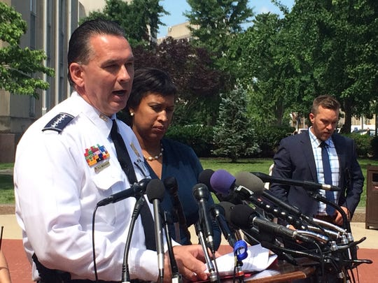 Washington Police Chief Peter Newsham, accompanied by Mayor Muriel Bowser, speaks to reporters in Washington, Wednesday, May 31, 2017, after a Pennsylvania physician who was behaving suspiciously and had made threatening remarks was arrested at the Trump International Hotel in Washington, police found an assault-style rifle and handgun in his car, authorities said. (AP Photo/Matthew Barakat)