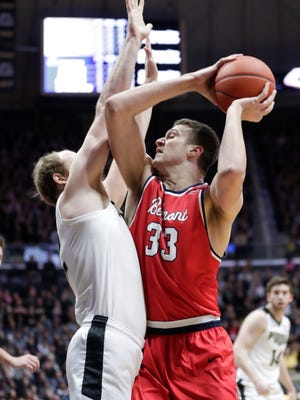 Belmont center Nick Muszynski (33) looks to shoots over Purdue forward Evan Boudreaux (12) during the first half of an NCAA college basketball game in West Lafayette, Ind., Saturday, Dec. 29, 2018. (AP Photo/Michael Conroy)