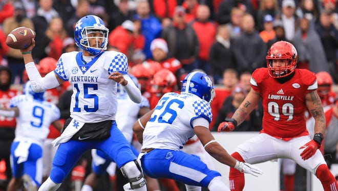 Kentucky's Stephen Johnson looks to throw in the first half. The Wildcats stunned the Cards 41-38 to take the Governor's Cup.