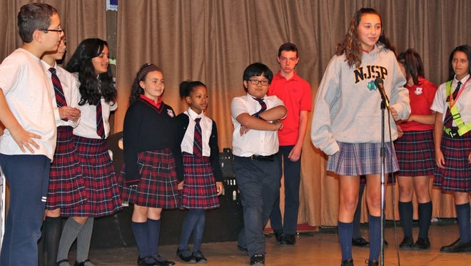 "Students from Bishop Schad Regional School rehearse a scene from the musical, ""Miracle on Bethlehem Street."""