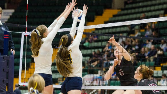 Yvette Burcescu(5) and Melissa Lussier  of Panas go up to block a shot from Burnt Hills Meghan Keyes (9) during the Class A State Volleyball Finals on Sunday November 22, 2015 at the Glens Falls Civic Center.