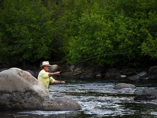 Marshall Smith casts his line while fly fishing in the Truckee River west of Reno on June 6, 2015.