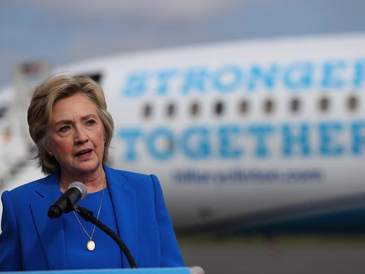 Hillary Clinton Speaks To The Press Before Departing For Campaign Trip To North Carolina