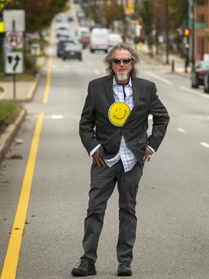 John Piccolo, owner of Piccolo's Restaurant and president of the Shrewsbury Street Area Merchants Association, stands Monday in the middle of Shrewsbury Street, the route of the Columbus Day parade for many years. He says the parade has always been good for all businesses along the route.