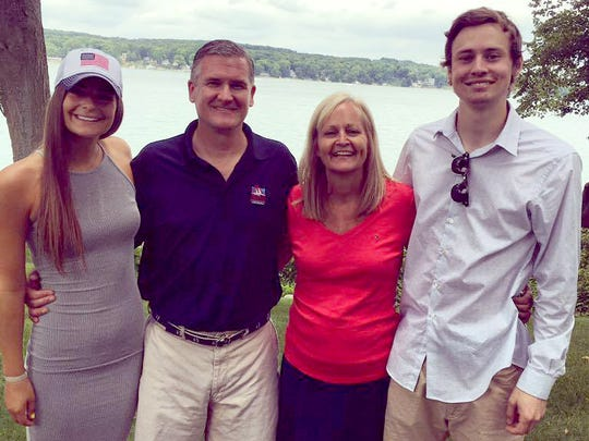Abbey Conner (left), the 20-year-old who recently died from alcohol poisoning on a vacation to Mexico, poses at Big Cedar Lake in West Bend on July 4, 2016, with her family, including brother Austin Conner (far right), 22, who also suffered from alcohol poisoning.
