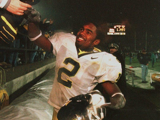 Charles Woodson, almost exactly 18 years ago, celebrating a 34-8 victory at Penn State. U-M was 9-0 and headed to a national title.