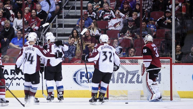 Oct 29, 2016: Colorado Avalanche center Mikhail Grigorenko (25) celebrates with teammates after scoring a goal in the second period against Arizona Coyotes at Gila River Arena.