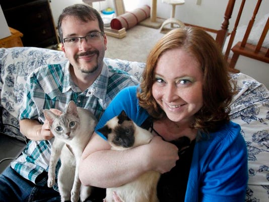 APC Couple with cats.jpg