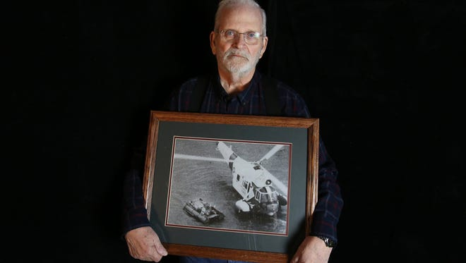 Dennis Hale is the sole survivor of the sinking of the Daniel J. Morrell in Lake Huron on November 29, 1966. In this photo, he holds a picture of himself being rescued from a raft by the United States Coast Guard on Nov. 31, 1966.