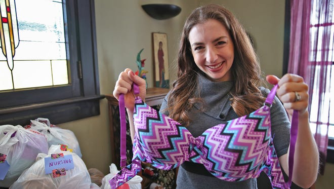 Rachael Heger shows some of the wide variety of 600+ bras she has gathered through donations, Wednesday, January 13, 2016.  She has gathered a large variety so far, from 32-A to 42-DD bras, nursing, and sports bras, that she will donate to local homeless women and others without the means to purchase the undergarments.  She turns 35 this December and has made a goal to collect at least 3500 used and new bras for distribution by her birthday.