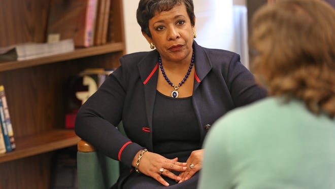 U.S. Attorney General Loretta Lynch (left) spoke with IMPD officer Jeff Patterson (not pictured) and his wife, Teresa Patterson (right), during Lynch's visit to the IMPD Training Center on Wednesday, April 13, 2016.