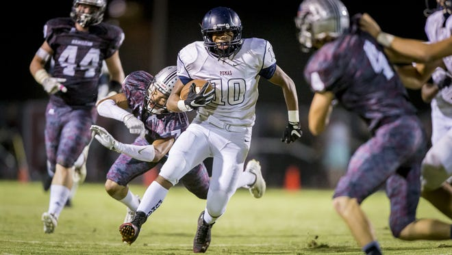 Wide receiver Nate James (10) of Perry runs the ball in for a touchdown in the first half against Hamilton at Hamilton High School on Friday, October 21, 2016 in Chandler, Arizona.