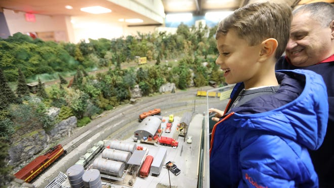 Dylan Thomas, 6, of Wyckoff watches the trains with his grandfather, Bob Heron. The Ramapo Valley Model Railroad is asking for just $1 to enter their annual holiday open house.  Their open house will continue on the afternoons of December 4,11 and 18.  This will be the final year they are located at 620 Cliff St. in Ho-Ho-Kus and are currently looking for a new location.  Sunday, November 27, 2016.
