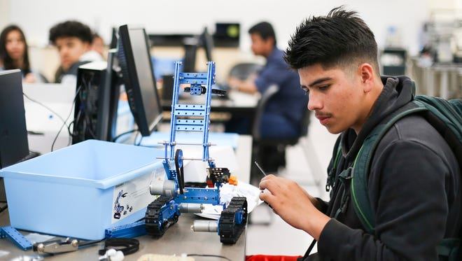 McKay High School student Christian Cuellar works on a robotics project in the migrant students summer program on Wednesday, July 12, 2017, at Chemeketa Community College. Migrant students whose families have moved for seasonal work in the last three years qualify for the program.