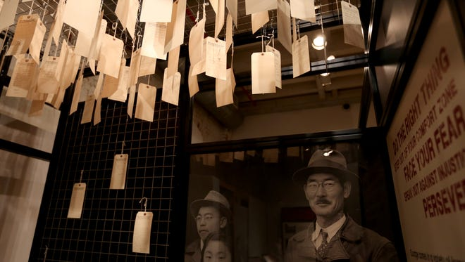 Visitors are encouraged to write down their own stories of fear and moral determination in the traveling exhibition debut of ÒCourage and Compassion: Our Shared Story of the Japanese American World War II Experience,Ó at the Willamette Heritage Center in Salem on Thursday, July 13, 2017. The Japanese-American history exhibit runs July 14 - Sept. 23.