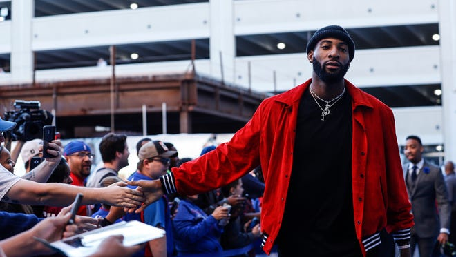 Andre Drummond high fives fans as he arrives before the Detroit Pistons' home opener against the Charlotte Hornets at Little Caesars Arena in Detroit, Wednesday, Oct. 18, 2017.