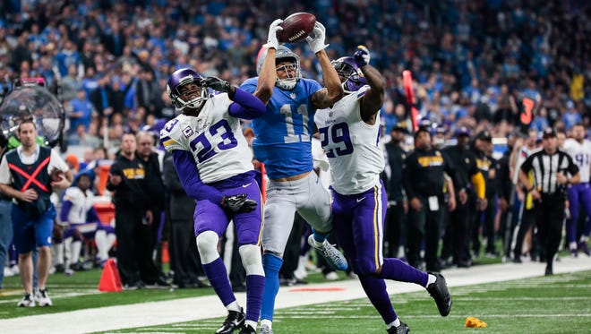 Lions receiver Marvin Jones makes a touchdown catch over Minnesota Vikings cornerbacks Terence Newman, left, Xavier Rhodes in the second half at Ford Field, Thursday, Nov. 23, 2017.