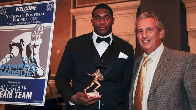 Detroit Free Press 2017 All-State Dream Team member Devontae Hobbs of Belleville poses for a photo with N.F.F. State of Michigan Chapter president Tony Versaci during the National Football Foundation State of Michigan Chapter awards banquet at the Dearborn Inn in Dearborn on Dec. 10, 2017.