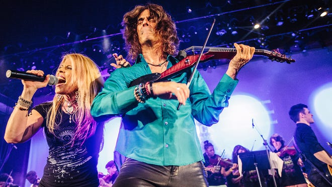 Mark Wood and his wife, vocalist Laura Kaye, are part of the Electrify Your Strings education program