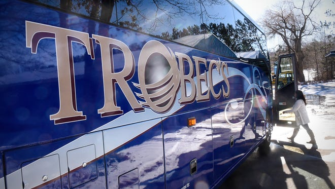 Trobec's Bus Service vice president Bethany Schubert enters one of the   company's coaches that will be used to transport family members of football players during the Super Bowl in Minneapolis on Feb. 4. .