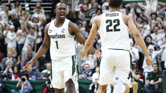 Michigan State's Joshua Langford, left, celebrates his 3-pointer with Miles Bridges during the second half on Wednesday, Jan. 31, 2018, at the Breslin Center in East Lansing. The Spartans won 76-68.