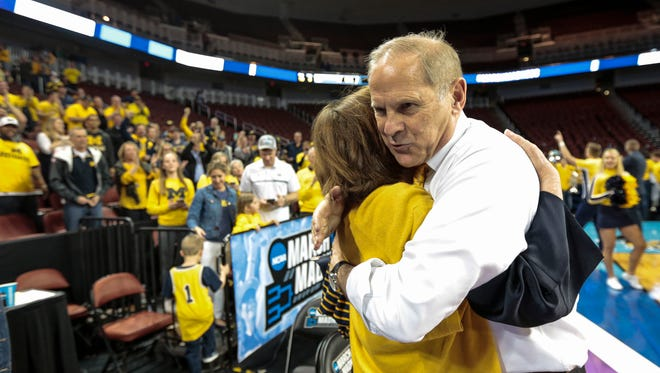 John Beilein hugs his wife, Kathleen, after defeating Houston, 64-63, in the second round of the NCAA tournament Saturday.