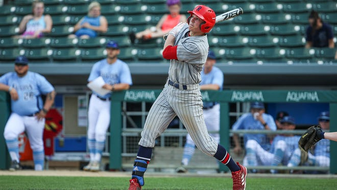 Roncalli Rebel Nick Schnell (7) hits a triple in the bottom of the first inning of the Marion County tournament final at Victory Field in Indianapolis, Monday, May 14, 2018. Roncalli won the Marion County title, 5-3.
