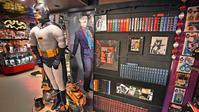 The Suit Wall of Kevin Silva's Batman Collection.