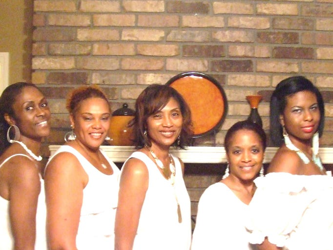 Janice Still (left), Deborah Taylor, Marilyn Cox,Yolanda Odom and Nadia Williams attend the all white party held in the West Shreveport home of Yolanda and Alvin Odom.
