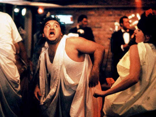 John Belushi in the toga party scene from 'Animal House.'