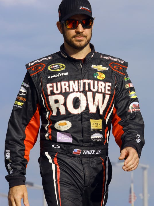 Martin Truex Jr. walks during driver introductions for the NASCAR Sprint Cup Series auto race Sunday, Nov. 22, 2015, at Homestead-Miami Speedway in Homestead, Fla. (AP Photo/David  Graham)