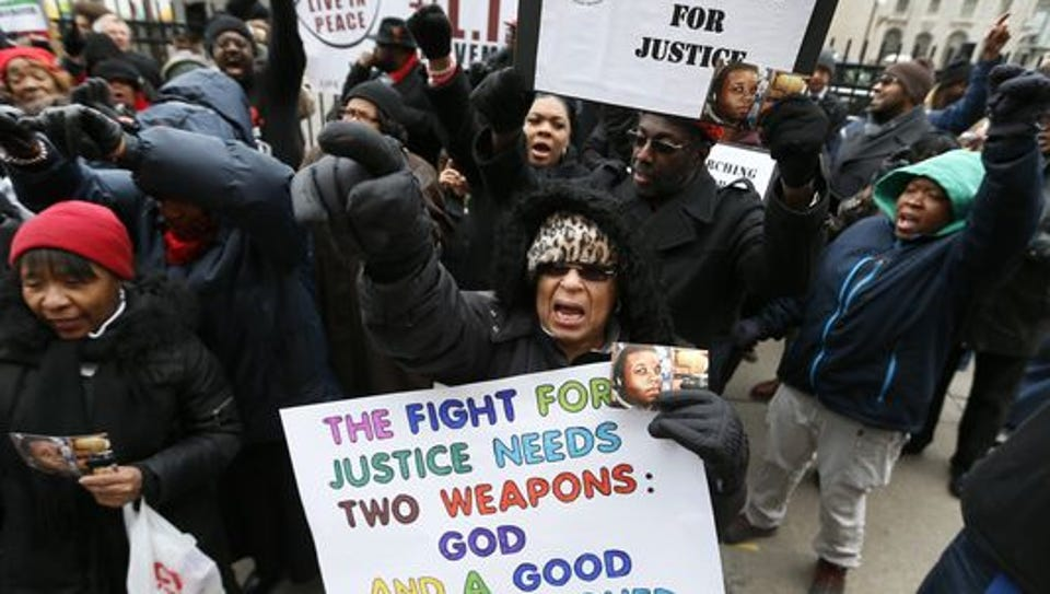 Renla Session, center, chants during a protest in Detroit
