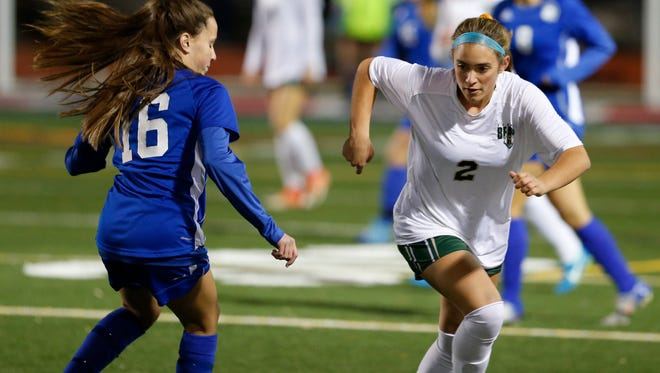 Vestal's Olivia McKnight drives past Maine-Endwell's Bella DiRosa during Thursday's Section 4 Class A final at Binghamton on October 26, 2017.