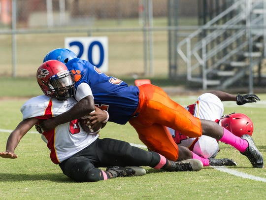 Arcadia's Lethan Williams (8) is sacked by Delmar's