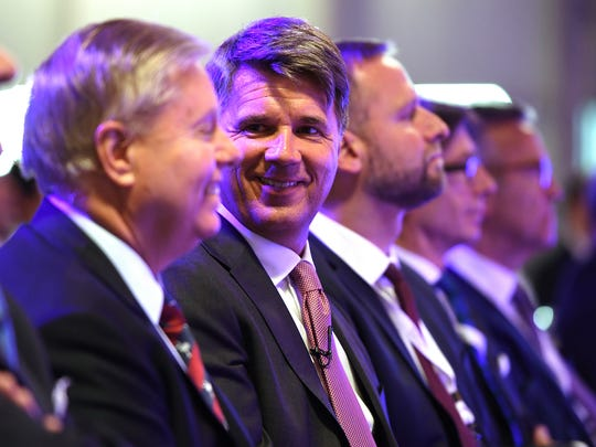 In this file photo, BMW Chairman and CEO Harald Krueger laughs with U.S. Senator Lindsey Graham during a ceremony at the plant on Monday, June 26, 2017 celebrating the 25th anniversary since BMW announced in 1992 the company would build the first production plant outside of Germany in South Carolina.