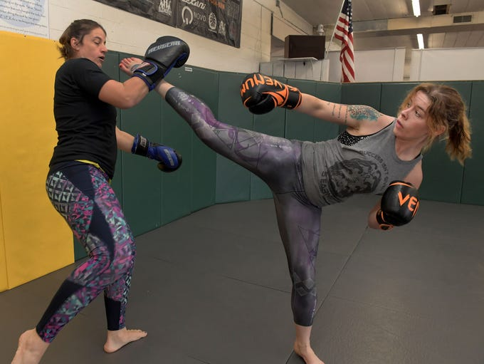 Shamir Peshewa, right, spars with Olivia Parker during