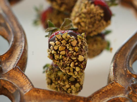 Chocolate-dipped strawberries with chopped pistachios.
