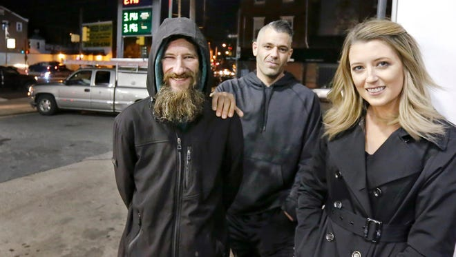 In this Nov. 17, 2017, file photo, Johnny Bobbitt Jr., left, Kate McClure, right, and Mark D'Amico, center, pose at a Citgo station in Philadelphia.