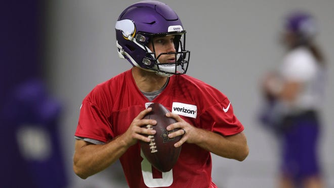 Minnesota Vikings quarterback Kirk Cousins rolls out during practice at the NFL football team's training camp Wednesday, May 30, 2018, in Eagan, Minn.